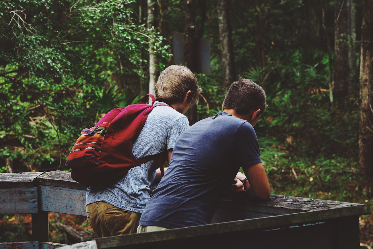 sharing the gospel rightly two friends guys talking image