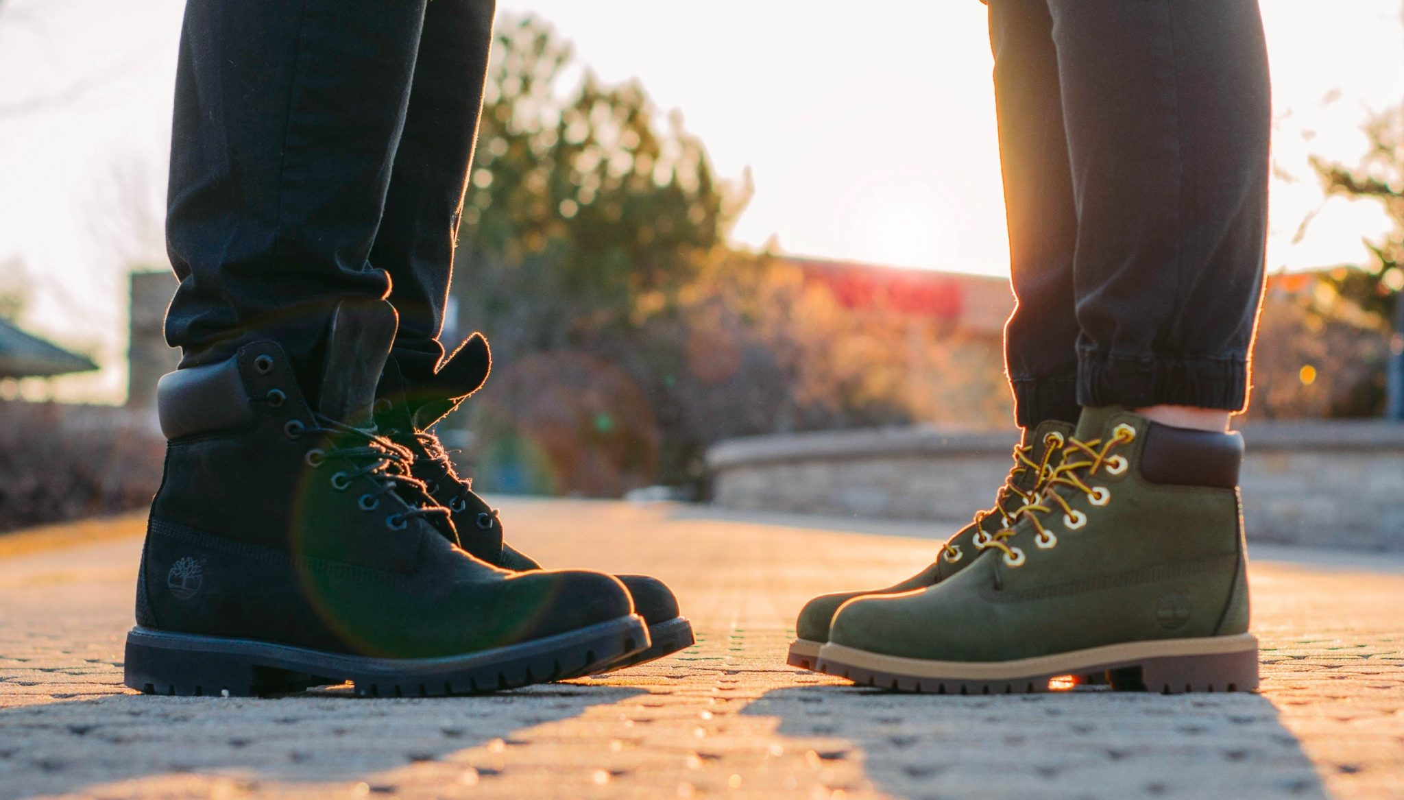 male and female boots facing each other